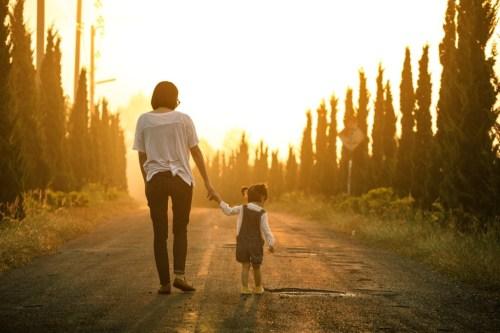 mother-daughter-walking-trees